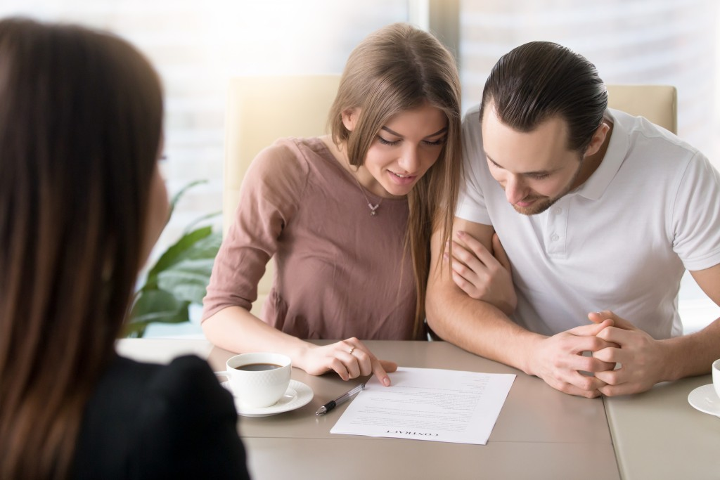 a couple looking at a contract