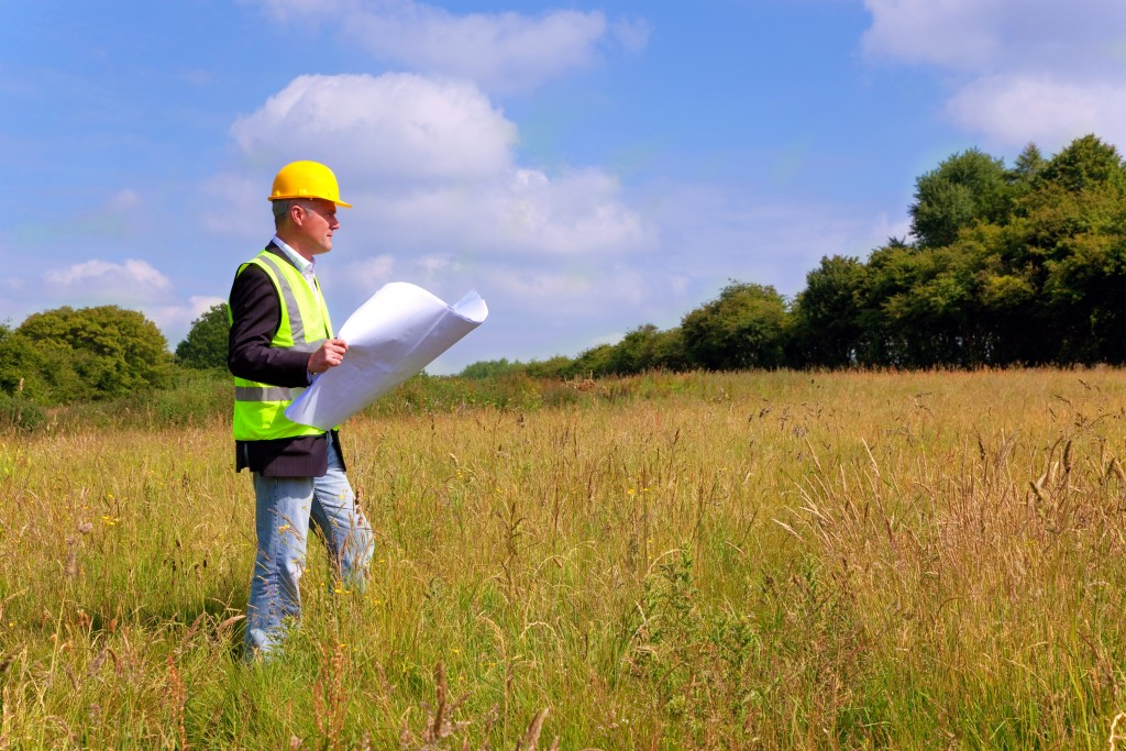 Engineer inspecting the land