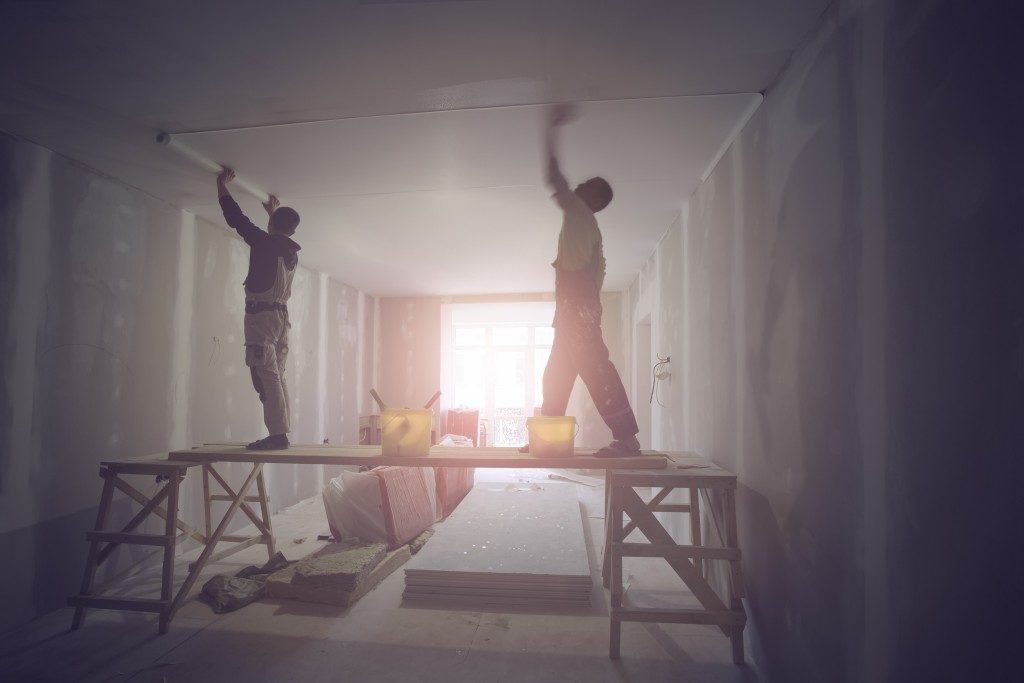 men renovating a home's interior
