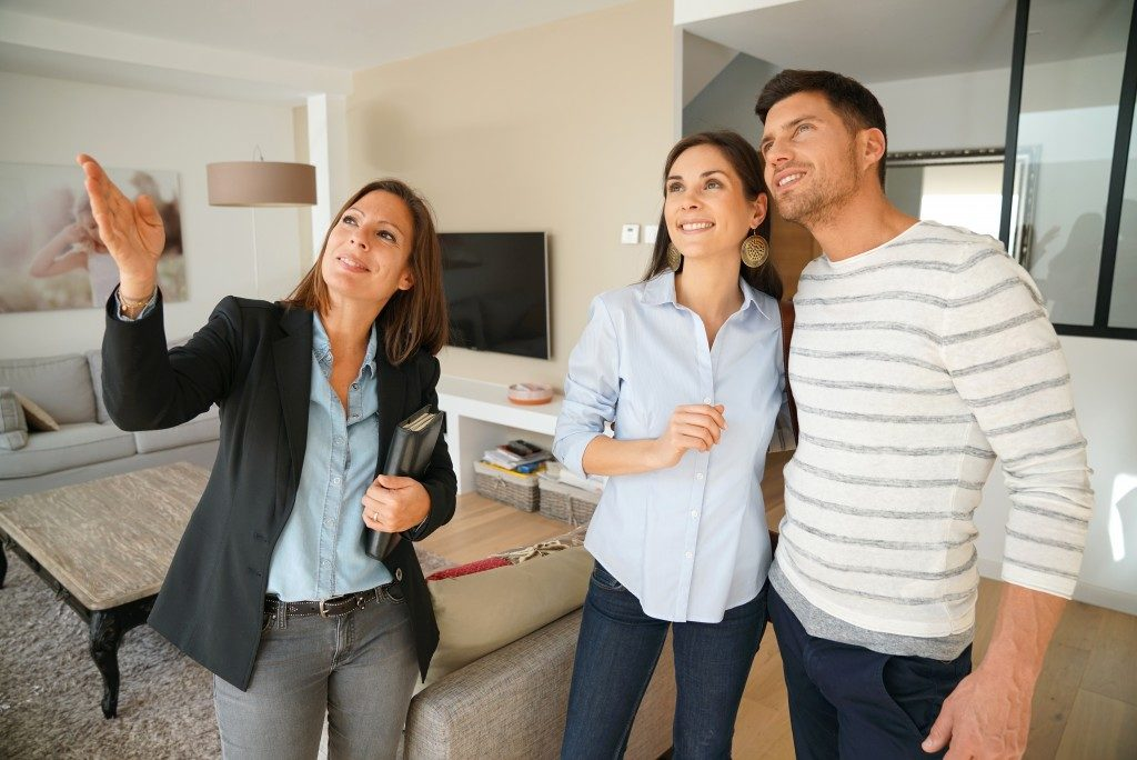 couple checking out a house with the realtor