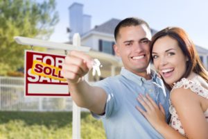 couple happy after purchasing house