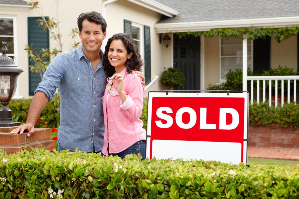 couple holding a house key